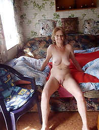 Gallant mature girl is posing almost undressed