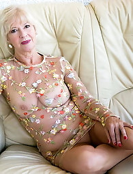 Staggering mature whore is fingering her twat